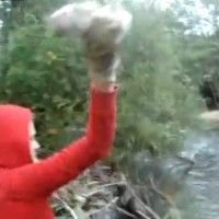 Girl Throws Puppies into a River