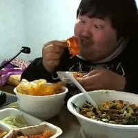 Fat asian guy loves his food