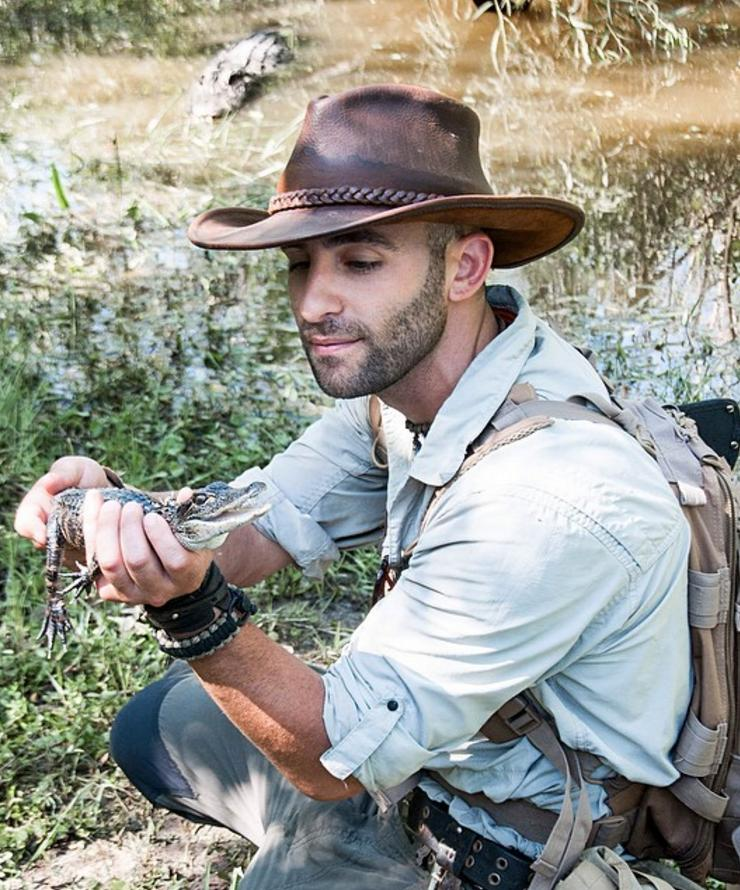 Coyote Peterson with a baby gator