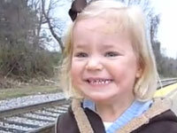 Toddler Delighted by Train