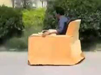 Chinese Man Drives a Comfy Chair