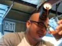 Man Pours Beer with His Forehead