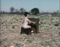 Nude Piano Player