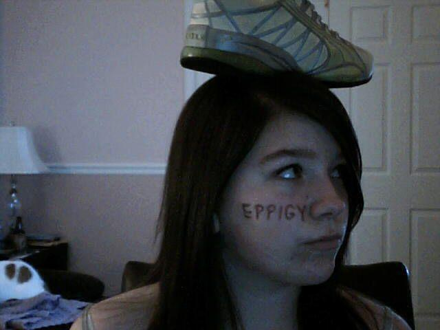 Cargirl_shoe_on_head.jpg