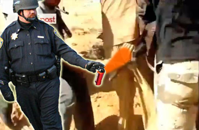pepper-spray-cop-gadaffi.jpg