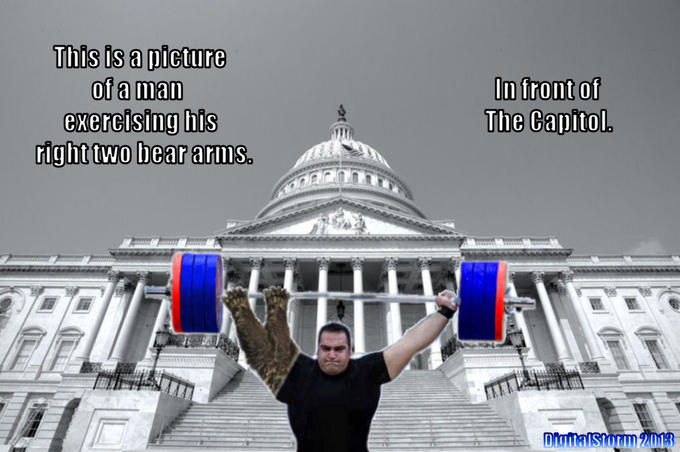 This is a picture of a man exercising his right two bear arms. In front of The Capitol.