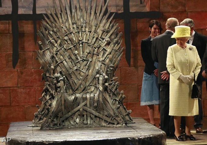 Queen Elizabeth II Checks Out the Iron Throne