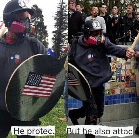 he protec abut he also attac meme of demonstrator with US flag on his wooden sheild