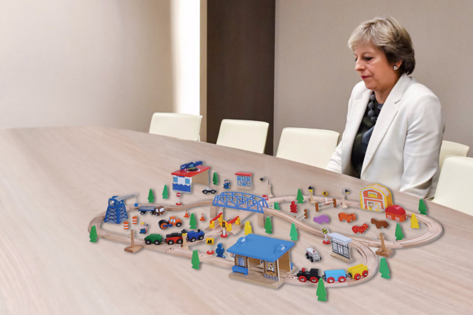 Lonely Theresa May playing with model trains on her table