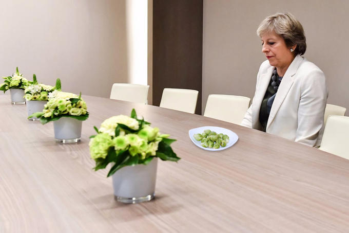 Lonely Theresa May eating Brussel sprouts