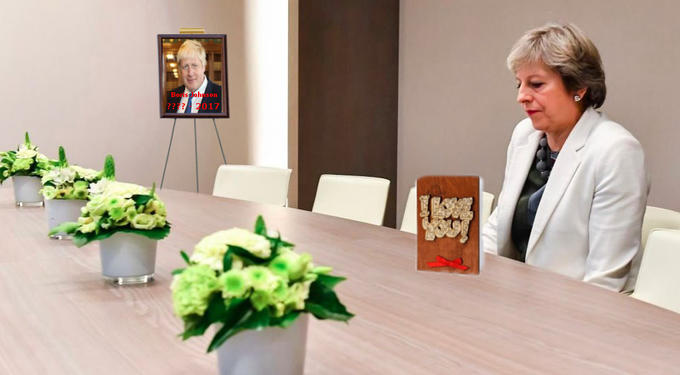 Lonely Theresa May meme as if it is Boris Johnson's funeral