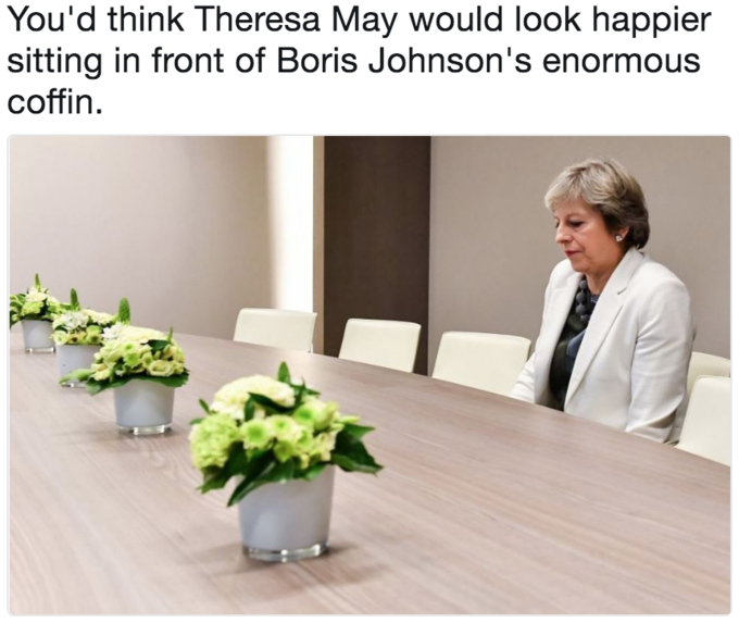 Lonely Theresa May meme joking that the table is a giant coffin of Boris Johnson
