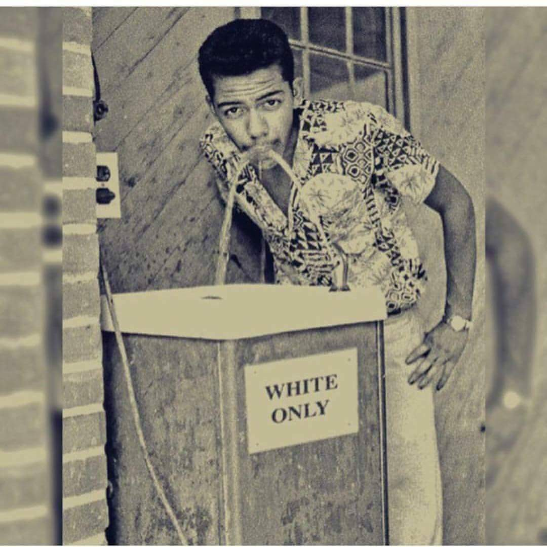 Black man sipping from whites only water fountain 1964 for Black and white only